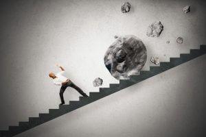 Eine Karriereleiter voller Steine im Weg